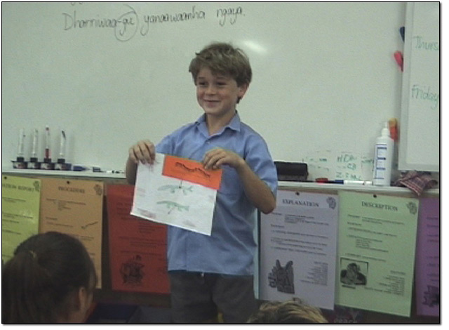 A Stage 2 student showing the class his worksheet