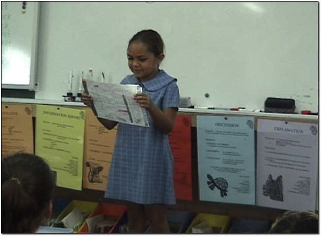 A Stage 2 student reading her worksheet to the class